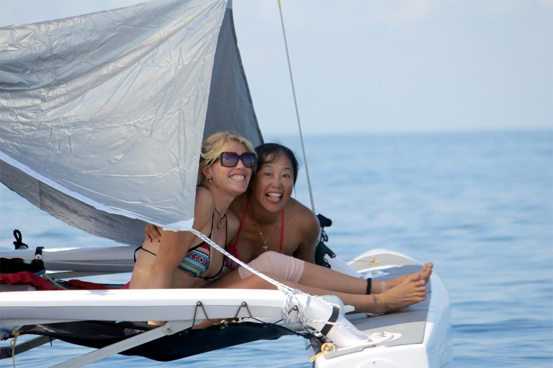 Liz Schoch relaxing on Pulse from Sail Escapes